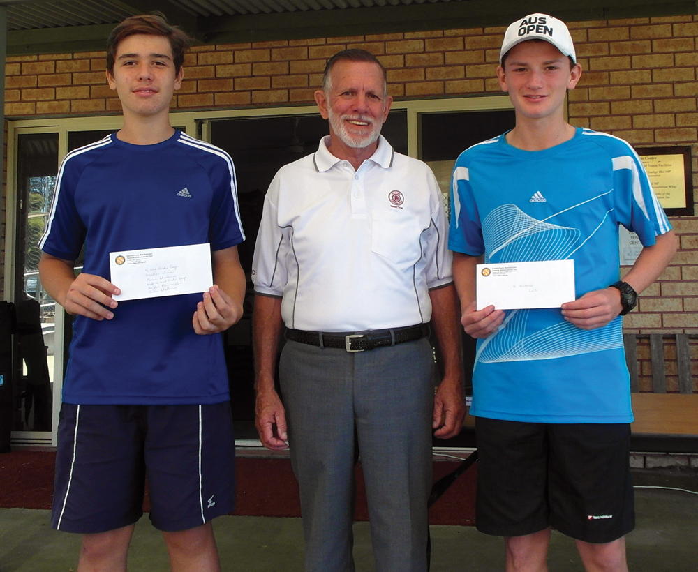 Revesby Workers' Tennis Club Elite Players Jesse and Beau receiving their awards from Director Dennis Hayward.